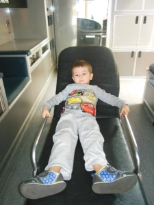 Resting (from jet lag) in the play ambulance and the Discovery Museum